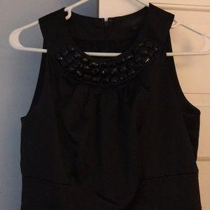 Sleeveless black dress. Never worn